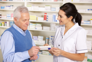 pharmacist servicing a customer